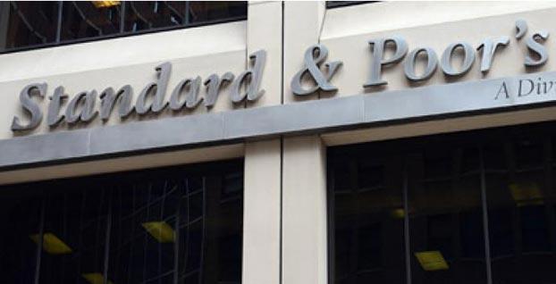 S&P, İspanya'nın kredi notunu teyit edip uyardı